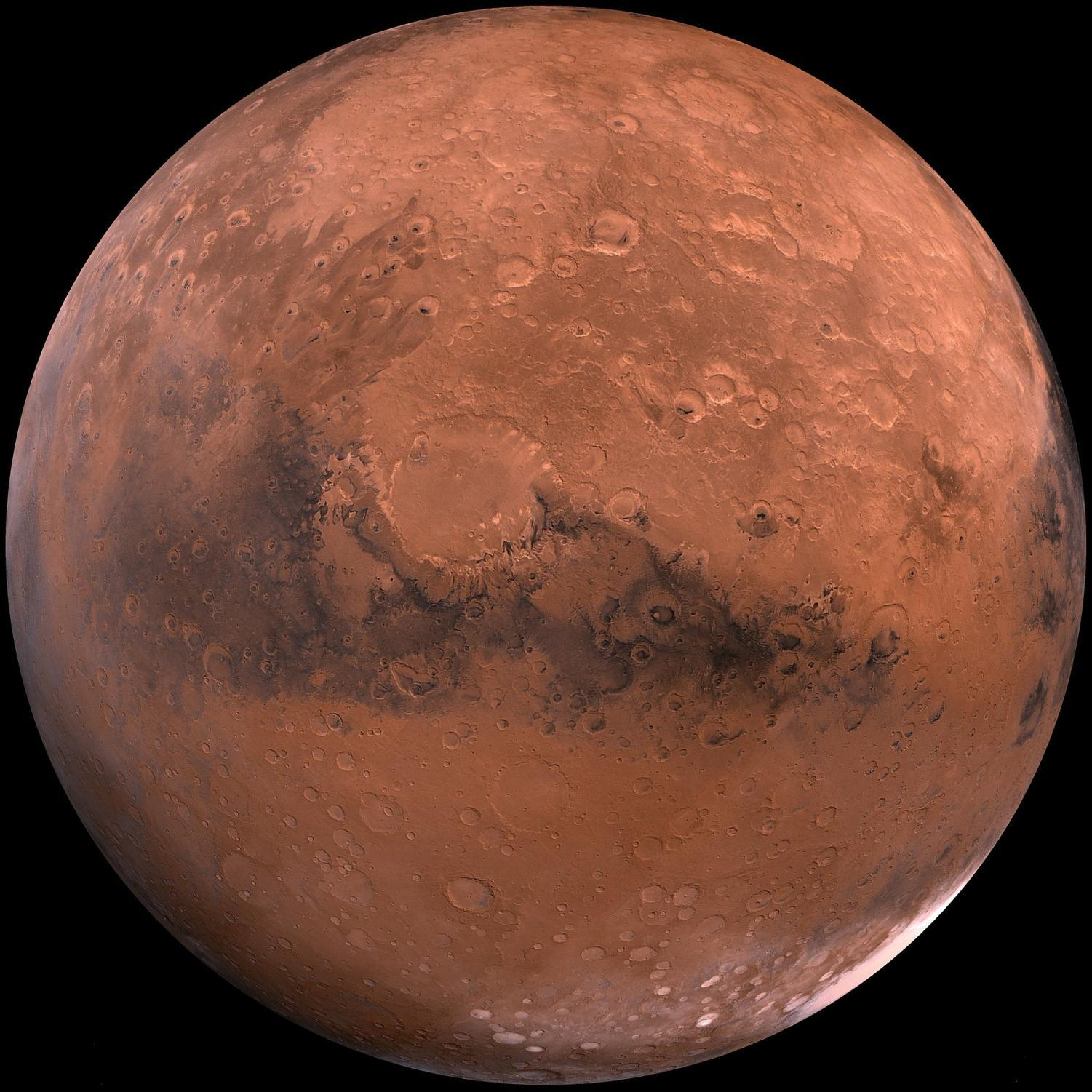 The face of Mars seen from outer space. Some ice can be seen at the poles.